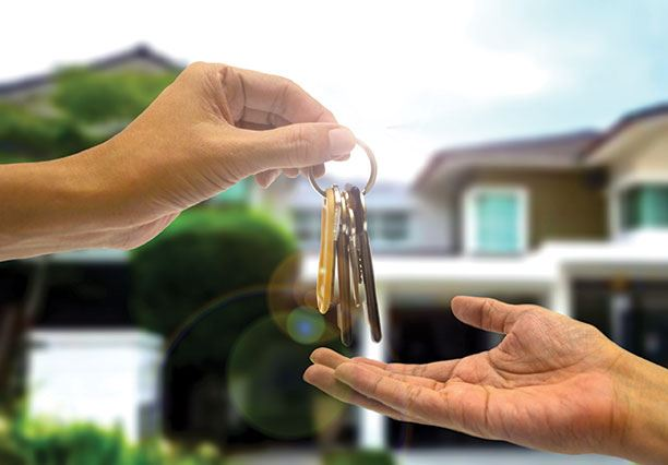 Image of someone handing off the keys to a new home