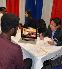 Image of Two Men Meeting at a Job Fair