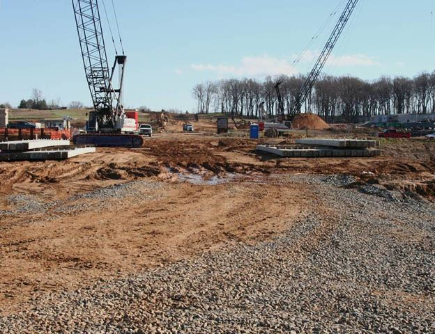 Site Road construction, dirt foundation for road, construction equipment, gravel