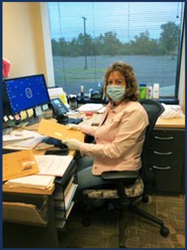 Heidi Stearlings working at her desk during COVID