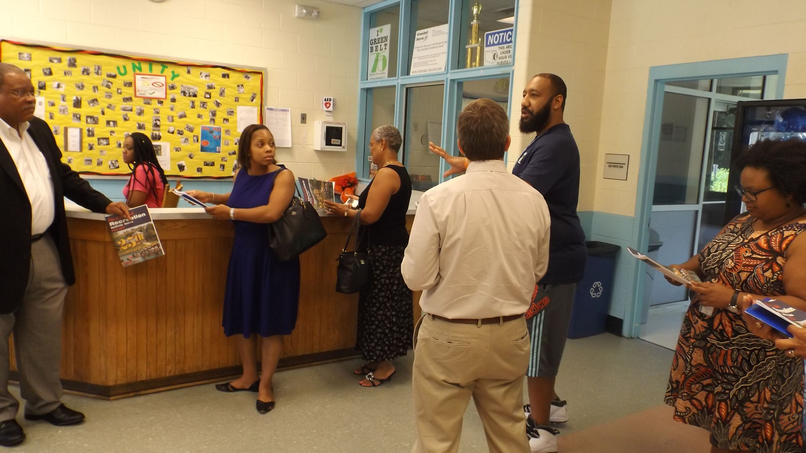 DHCD Staff Tours Interior of Springhill Lake Rec. Ctr.