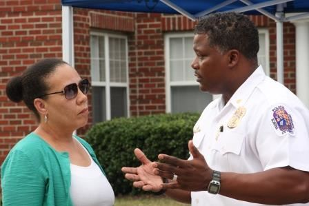Photo of a Police Official in dialogue with a citizen